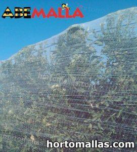 ABEMALLA® instalada sobre arboles en campo de cultivo