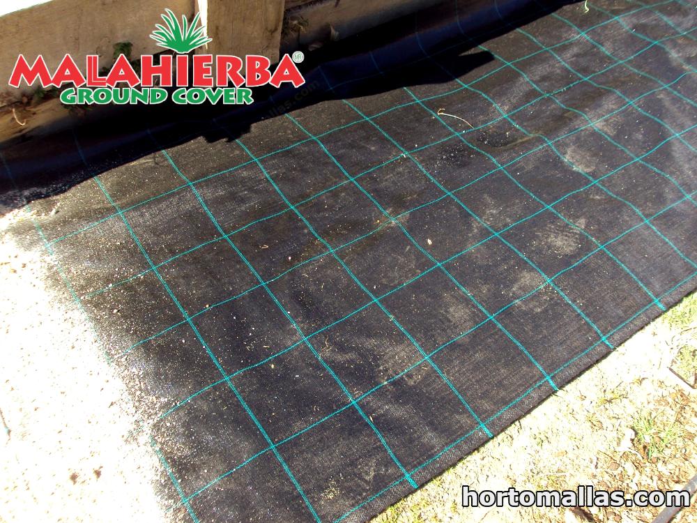 tela MALAHIERBA® ground cover colocada sobre suelo