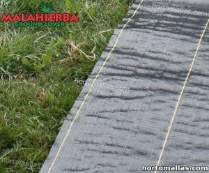 MALAHIERBA® ground cover fabric placed on grass