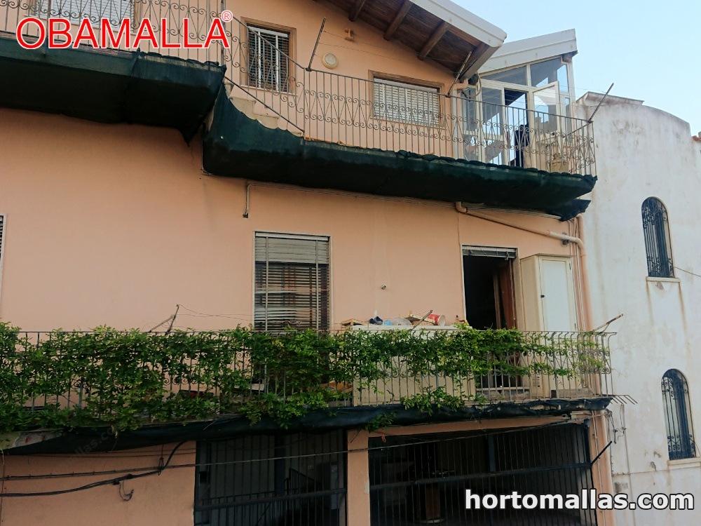 Malla sombra para balcones. Protección de caída de enjarres y de escombros.
