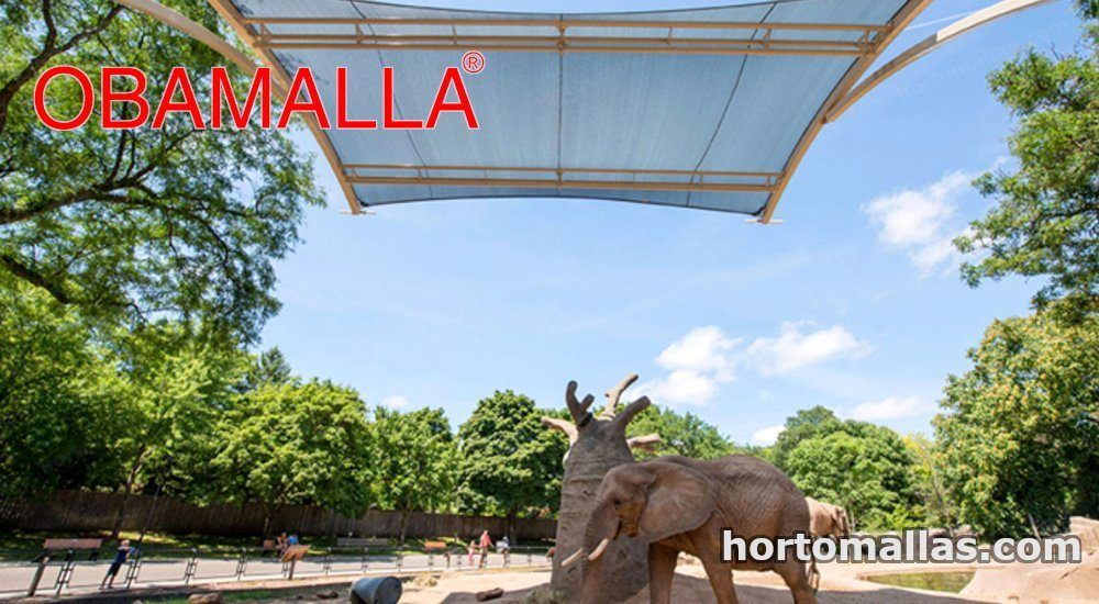 elefante protegido por Malla sombra para animales OBAMALLA® del sol